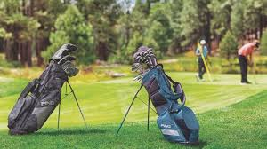 best golf bags 2019 two men play golf with their golf bags in the foreground