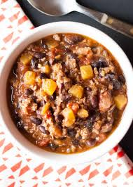 pumpkin chili made with chunks of pumpkin ground pork black beans a bottle of beer and plenty of spices ready in under an hour even better the next