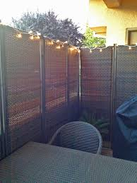 A private outdoor dining area is created with our 3-Panel Wicker Partitions.
