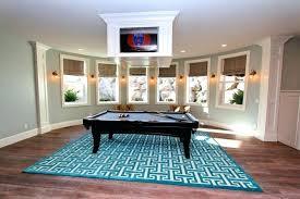 pool table rug grey wall multiple window 4 way television media room area wooden floor size