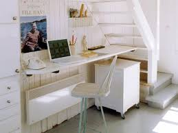 creating home office. small home office design under staircase with white furniture creating