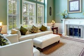 decorating living room with fireplace bookcases and windows