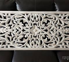 white carved wood wall panel home decor repurposing upcycling on white wooden wall art