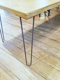 I like to bring my legs right up to the edge of my tables, but some people  prefer to put them inside a bit to exaggerate the angled look of hairpin  legs.