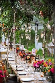 Weddbook  Wedding table design for garden wedding. Wedding decoration with  candle and pink & orange flower.
