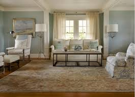 living room in pastel colors with an antique area rug