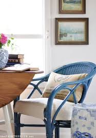 give some inexpensive outdoor chairs a fresh pop of colour and bring them inside to add a cal touch to your dining room or breakfast nook