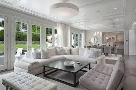 white linen sectional with black coffee table