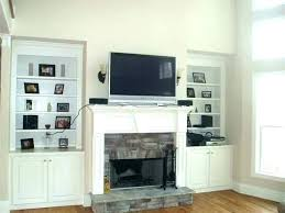 hiding tv wires over fireplace hide over fireplace how to hide wires over brick fireplace mounting
