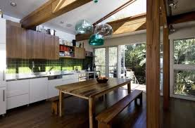 lucid lighting. trio of fly pendant lights in a rustic kitchen lucid lighting
