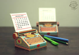 Here's a quaint little 3D Paper Desk Calendar for your mantelpiece,  table-top or shelf in the form of a typewriter, with 12 month cards with  dates.