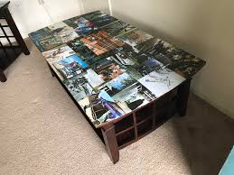 i took a coffee table book and covered my coffee table in its pages then resin coated it
