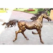 a young bronze horse trotting