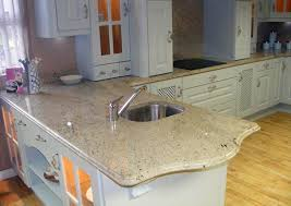 ivory fantasy granite countertops in a white kitchen