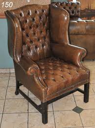 150 brown leather tufted wingback chair 44 high on liveauctioneers
