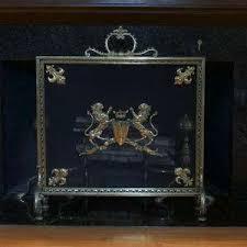 antique fireplace screen. antique fire screen with lion motif fireplace e