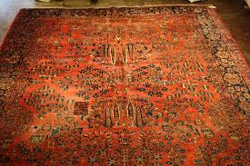 antique persian sarouk rug with some repair