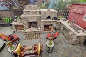 elegant outdoor griddle in landscape mediterranean with outdoor grill ventilation next to backyard bbq grills alongside