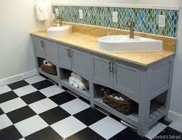 custom built shaker style bathroom vanity with geometric backsplash sawdust and embryos