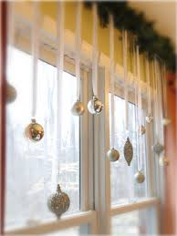 Hang Christmas ornaments with ribbon & wrap your curtain rod with pine  garland. Such a simple idea to dress up your windows - but it really only  works if ...