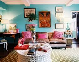 Consider a mix of bright colors, antique furniture and tribal wall art to  create an