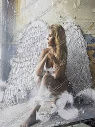 an angel with white wings sitting in a room picture with crystals art bevelled mirror frame