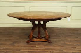 solid walnut round arts and crafts expandable dining room table