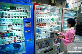 Woman Vending Machine Best Woman Buying Cigarettes From Vending Stock Photo