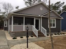 very nice 3 bedroom 2 bath home on oak island open floor plan this home boasts laminate floors in the living dining and kitchen cathedral ceilings