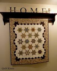 Quilt Kisses: Different Ways to Hang Quilts & It also mounts into the studs and is really secure. He drilled holes into  the side boards for the rod to slide through. Originally it was just a  plain rod, ... Adamdwight.com