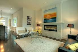 stone electric fireplace with contemporary wall sculptures living room modern and stacked dark wood floor for modern wall sculptures