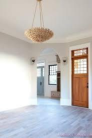 gray family room living room light gray walls grey gold chandelier