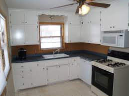 astounding white painted kitchen cabinets ideas as well as ceiling fan lights over l shape white cabinets designs