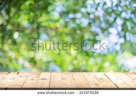 Creativity Wood Table Perspective And Green Leaf Bokeh Blurred For Decorating Ideas