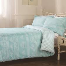 this duck egg blue and white duvet cover set is the perfect addition to any bedroom the white heart design is printed throughout the pattern also