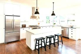 white kitchen black island off cabinets with nantucket granite top