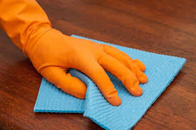 Best way to clean wood furniture Fix Gloved Hand Cleans Wooden Piece Of Furniture With Blue Rag How To Clean Things How To Clean Wood Furniture