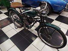 a 1948 american flyer whizzer powered motor bike on display in the martin auto museum