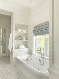 waterworks bathtub flanked by built in shelves