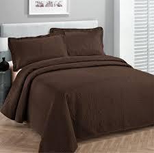 image of fancy brown coverlet