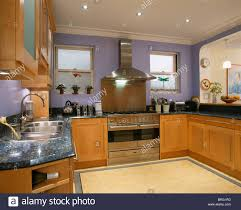 kitchen down lighting. Stainless Steel Range Oven And Extractor In Modern Mauve Kitchen With Fitted Wood Units Down-lighting Down Lighting N