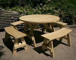small round folding picnic table with detached benches in the garden ideas