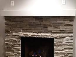 white stone fireplace clean lines a traditional gas with natural surround white stone fireplace