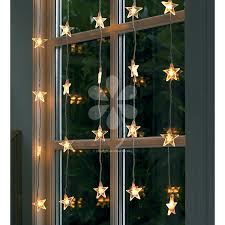 Attaching Christmas Lights Inside Windows An Elegant Star Light Curtain To Hang Inside Your Window Or