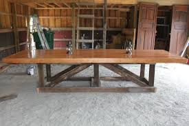 long and large easy diy trestle farmhouse dining table with solid wooden top and reclaimed wooden base for rustic dining room design ideas