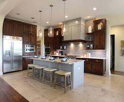 burrows cabinets kitchen cabinets in stained perimeter cabinets and gray island craftsman range hood and