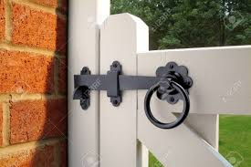 ring latch on white garden gate stock photo 27550575