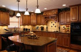 kitchen recessed lighting ideas. Kitchen Recessed Lighting Design With Wooden Cabinet And Stone Backsplash Also Black Cooktop Facing Small Granite Countertop Island Ideas