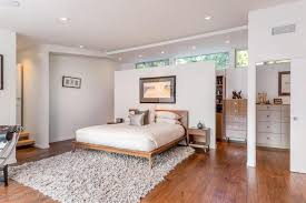 Image Dark Wood Large Master Bedroom With Light Wood Floor And Shag Area Rug Love The Screen Home Stratosphere 101 Master Bedroom With Hardwood Floors 2019