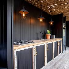 country chic outdoor kitchen with cupboards